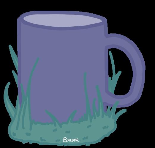 Une tasse dans l'herbe